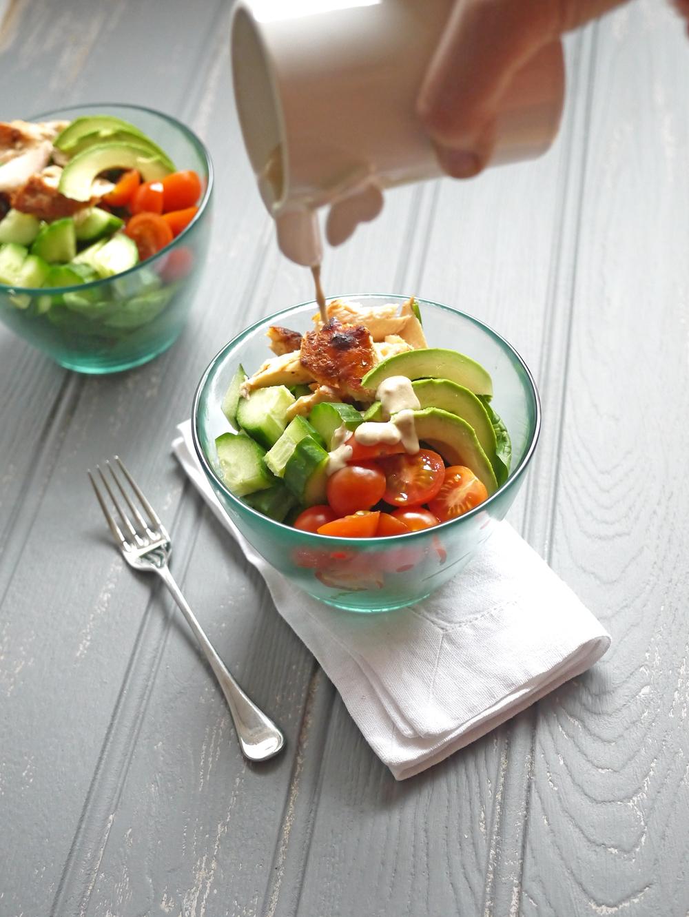 Salmon Salad with Lemon Tahini Dressing Pouring Dressing