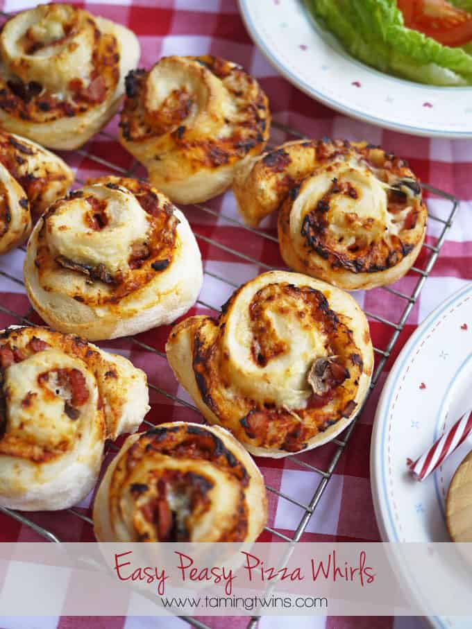 Easy Peasy Pizza Whirls - A great teatime recipe for children and families. These also make a super lunchbox filler or picnic treat. Get the kids cooking, helping to make them too, they're great fun! http://www.tamingtwins.com