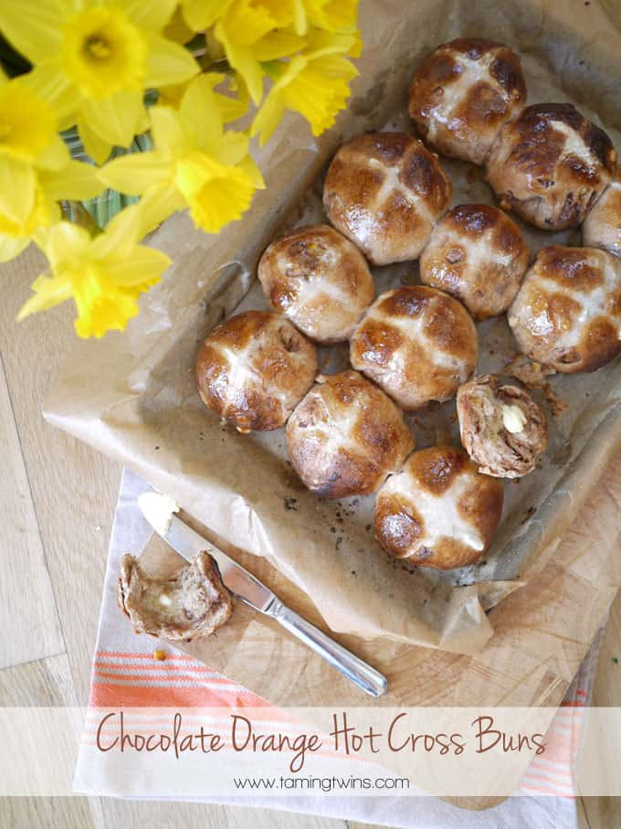 Chocolate Orange Hot Cross Bun - A delicious teatime treat for Easter, a twist on the original and a really fun bake over the spring holiday period. | http://www.TamingTwins.com