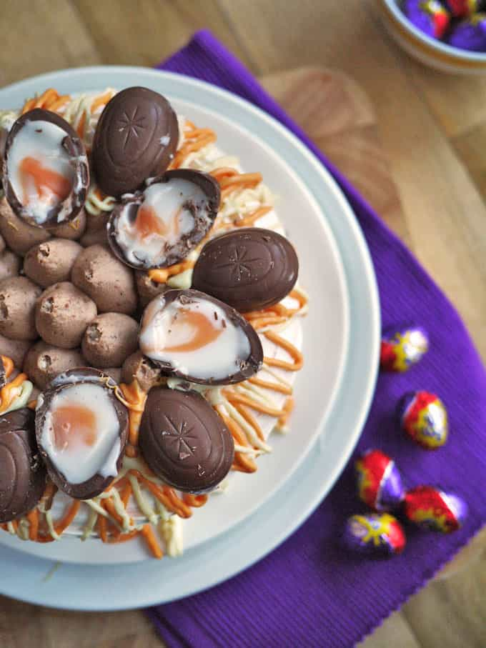 Cadbury's Creme Egg Pavlova Recipe - A delicious, super quick, Easter dessert. You can whip this pudding up in just 5 minutes for real holiday WOW factor! http://www.tamingtwins.com