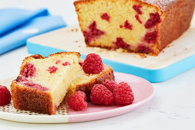Quick and Easy Raspberry Loaf Cake made with Optiwell Yoghurt Drink for extra flavour and protein. A really simple tea time treat, it keeps well and works every time. http://www.tamingtwins.com