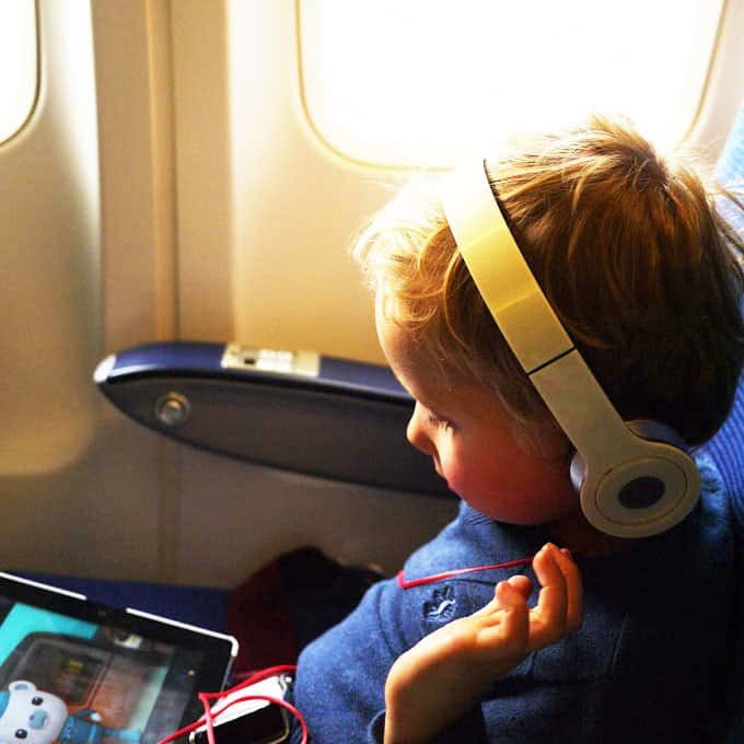 Travelling with kids? Here are my top tips for flying with toddlers having survived lots of flights with two children, here's what you need for your plane journey. http://www.tamingtwins.com