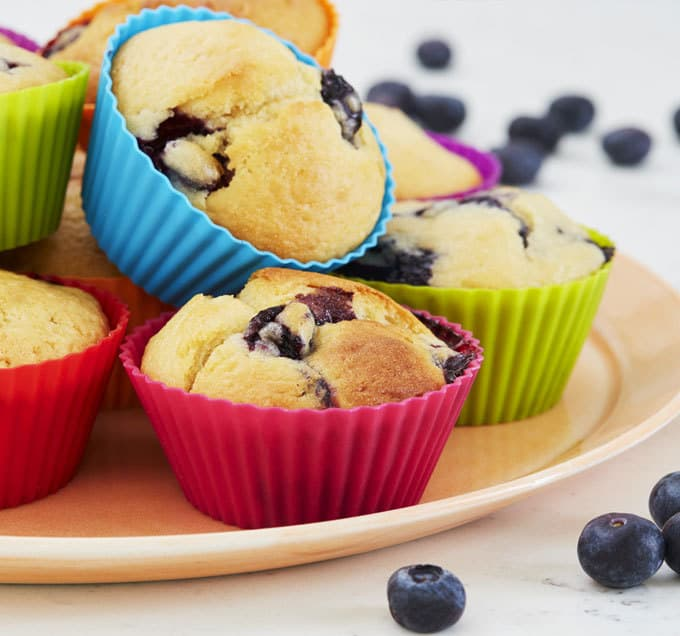 Blueberry muffins made with Optiwell yoghurt drink, for a deliciously tasty cake. Perfect for breakfast or an afternoon tea treat. http://www.tamingtwins.com