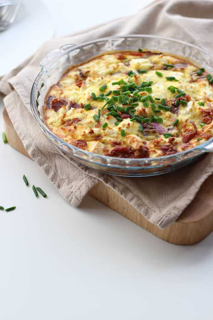 This crustless quiche with feta and parma ham is a perfect quick family meal. Made without pastry for a lighter meal, packed with tasty tomatoes and eggs for a protein rich dinner. http://www.tamingtwins.com