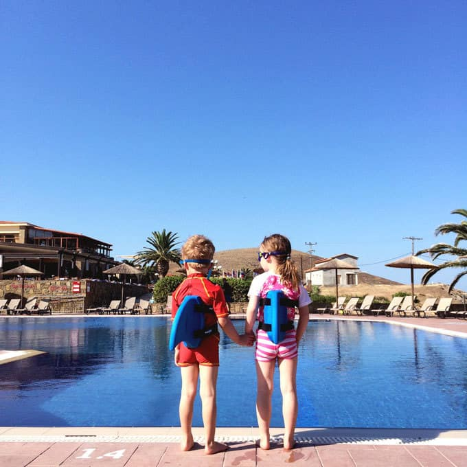 Postcards from our week at Lemnos Village, Greece with Mark Warner... Blue skies over a beautiful bay! http://www.tamingtwins.com
