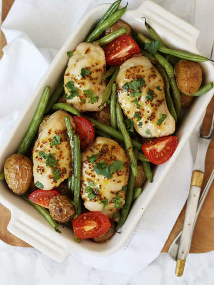 Honey Mustard Chicken Traybake - Chicken breasts baked with honey and mustard, for a deliciously sticky and tasty one pan meal. With added new potatoes, green beans and tomatoes for a complete meal.
