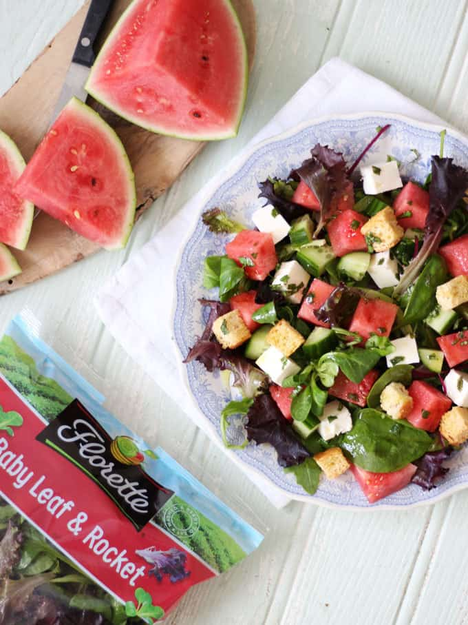 A watermelon feta salad with fresh mint dressing, baby leaves and rocket. A light and delicious summer salad, with added croutons to make a meal of it. Perfect for an al fresco lunch or dinner. http://www.tamingtwins.com