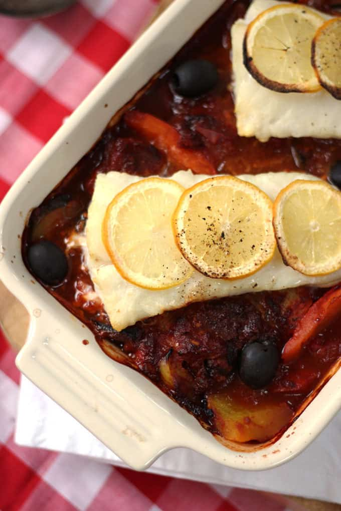 A quick and easy midweek dinner, light and fresh Italian baked cod. Packed with tomatoes, peppers and olives, this oven cooked fish recipe is also Slimming World friendly. http://www.tamingtwins.com