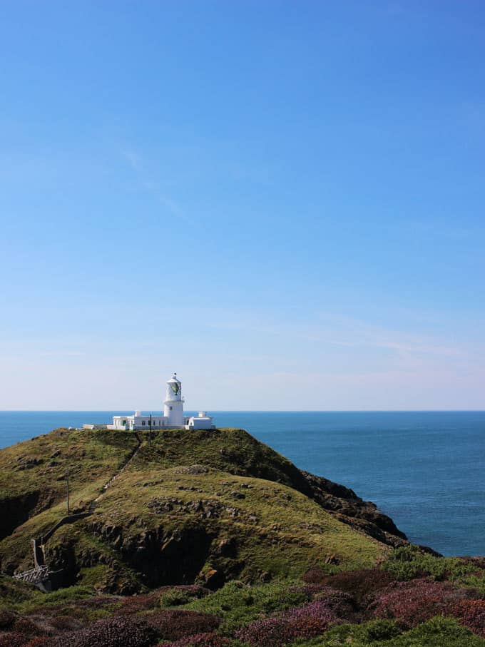 Discovering Pembrokeshire, Wales - 48 Hours with kids in this stunning part of the UK. Beautiful coastlines, beaches, lighthouse and views, with amazing food and blue skies. What more could you want for a holiday?