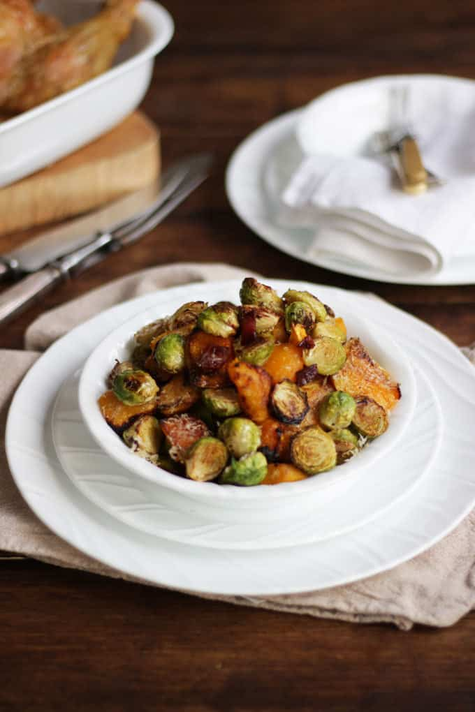 Oven baked Brussels sprouts with with butternut squash, bacon and Parmesan cheese. The best ever Brussels sprouts, oven roasted for the perfect Christmas side dish.