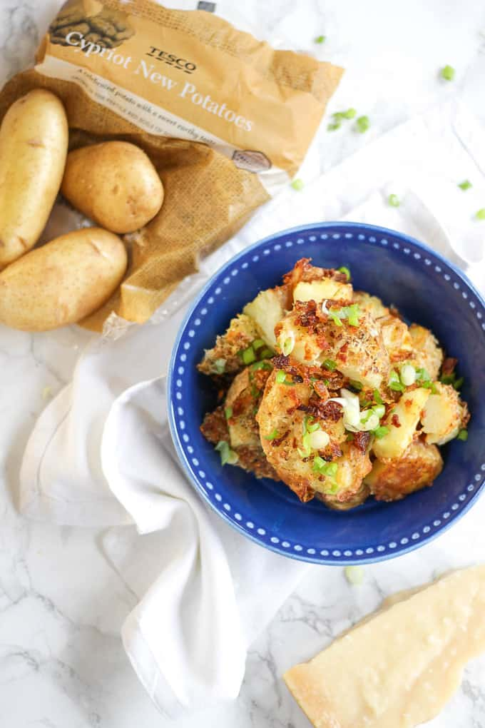 Garlic Parmesan Crushed Potatoes - Crunchy, crispy, crushed new potatoes, smothered in garlic and Parmesan cheese. The ultimate accompaniment side dish.