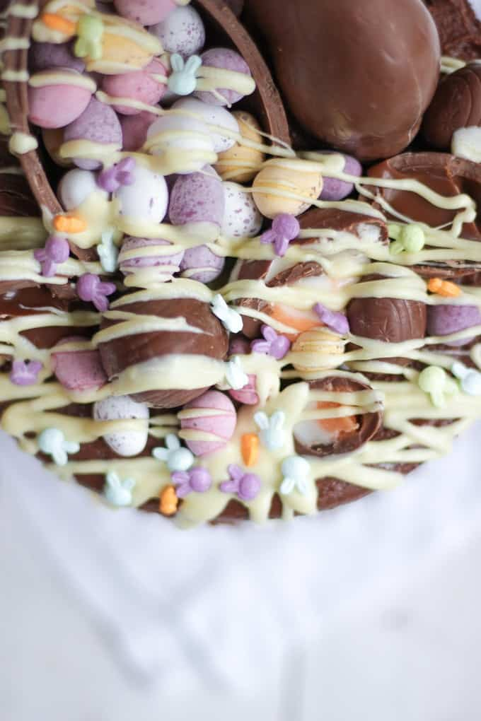 The Ultimate Easter Chocolate Cake! Overload on Easter treats in this decadent, delicious and rich Easter chocolate cake. Topped with Cadbury's Creme Eggs, Mini Eggs, white chocolate drizzle, bunnies and Caramel Eggs. What more could you need in an Easter dessert?!