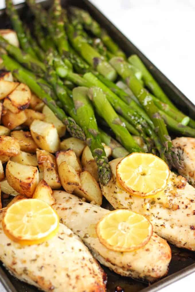This One Pan Lemon Asparagus Chicken recipe is a quick and simple dinner using chicken breasts, roasted with potatoes, asparagus, lemon and honey. A really easy family meal.