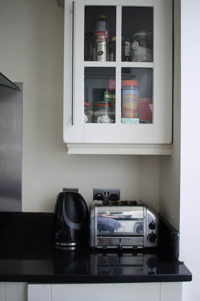 Dualit toaster in situ. A grey kitchen tour. This light and airy kitchen, included wooden cabinets painted gray, bi-fold doors, Velux window roof lights, an Instagram photo gallery wall, black tile floor, wooden floor, HUGE island unit and heaps of other ideas for monochrome kitchen and dining areas.