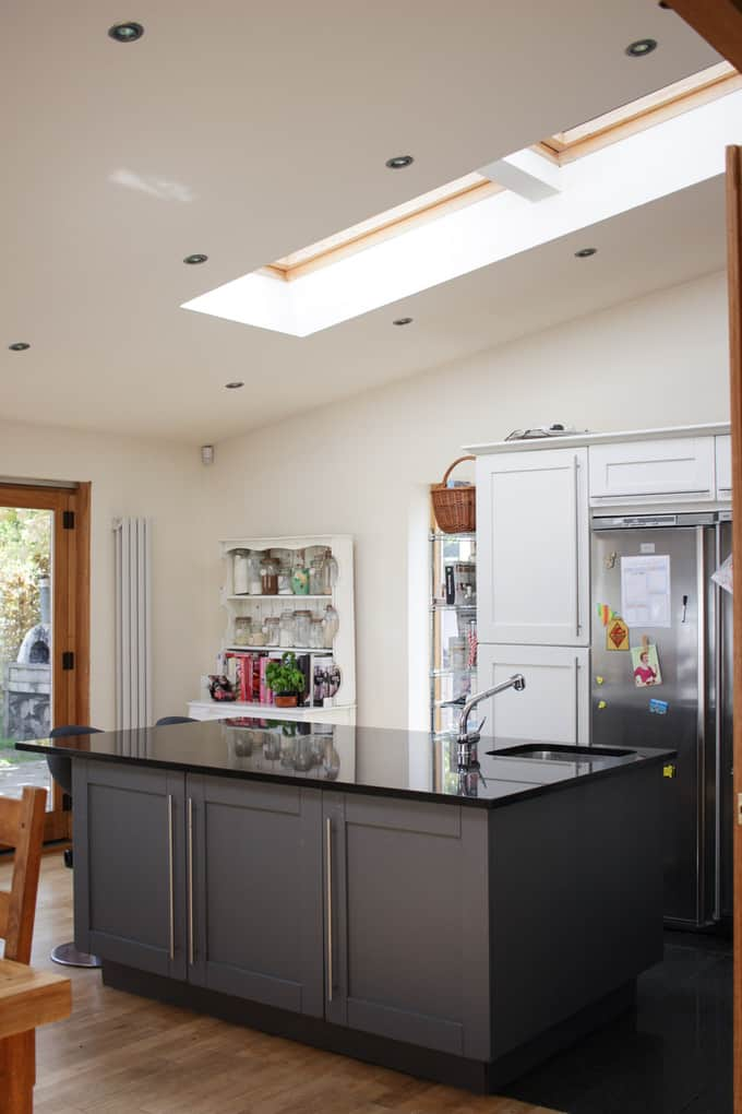A grey kitchen tour. This light and airy kitchen, included wooden cabinets painted gray, bi-fold doors, Velux window roof lights, an Instagram photo gallery wall, black tile floor, wooden floor, HUGE island unit and heaps of other ideas for monochrome kitchen and dining areas.
