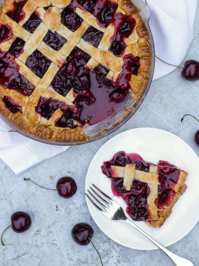Cinnamon Cherry Pie Lattice Recipe - Made with delicious, juicy, fresh cherries. The perfect summer time dessert.