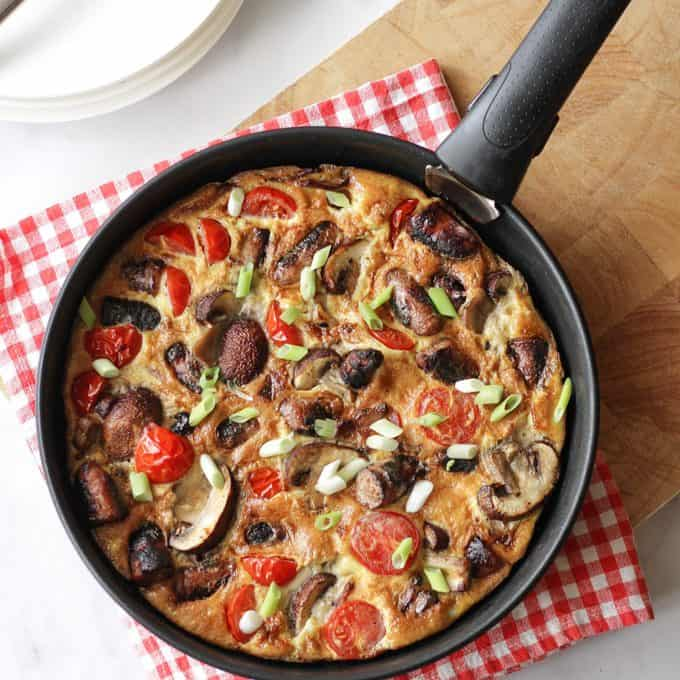 "Full English Breakfast Omelette - The easiest ever ""fry up"" breakfast, all cooked in one pan. Packed with sausages, bacon, mushrooms, tomatoes and eggs. Perfect for breakfast, lunch or brunch."