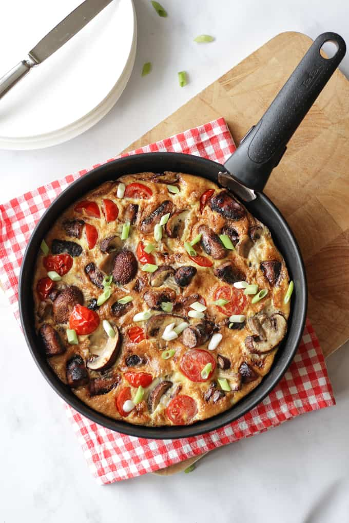 """Full English Breakfast Omelette - The easiest ever """"fry up"""" breakfast, all cooked in one pan. Packed with sausages, bacon, mushrooms, tomatoes and eggs. Perfect for breakfast, lunch or brunch."""