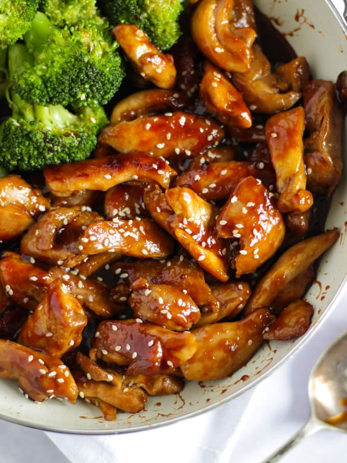 Frying pan with Teriyaki Chicken and sticky sauce and broccoli in