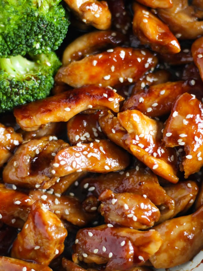 Chicken teriyaki sprinkled with sesame seeds and broccoli in the pan