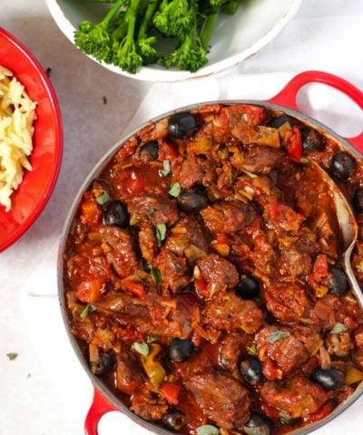 Pork casserole in tomato sauce with orzo pasta and tender stem broccoli