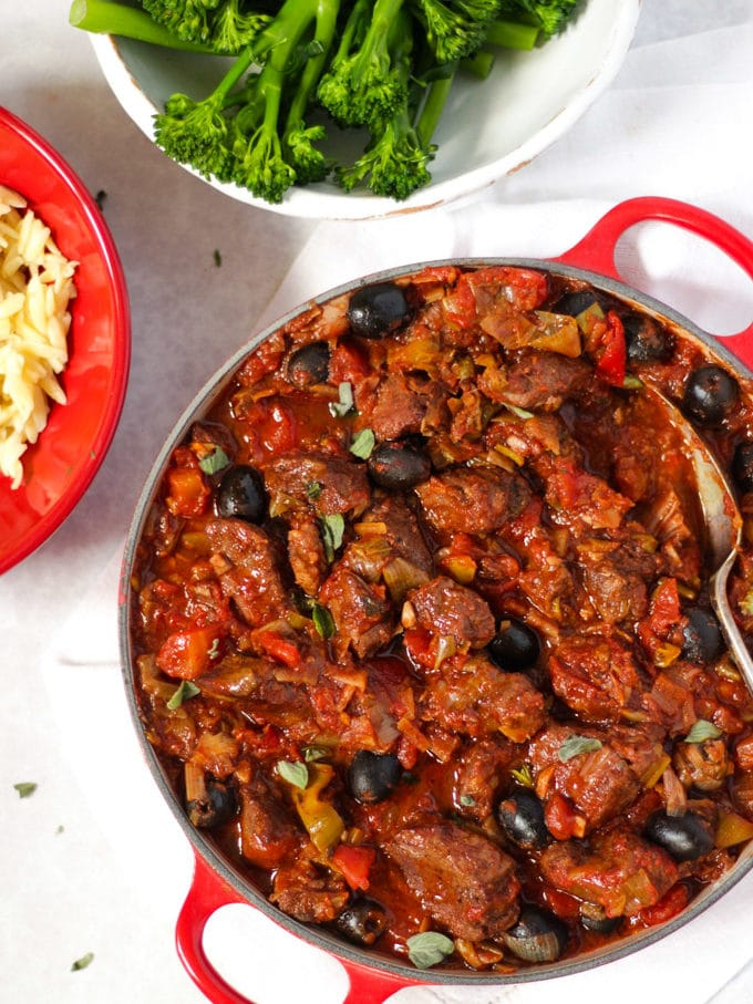 Pork casserole in tomato sauce with orzo pasta and tender stem broccoli