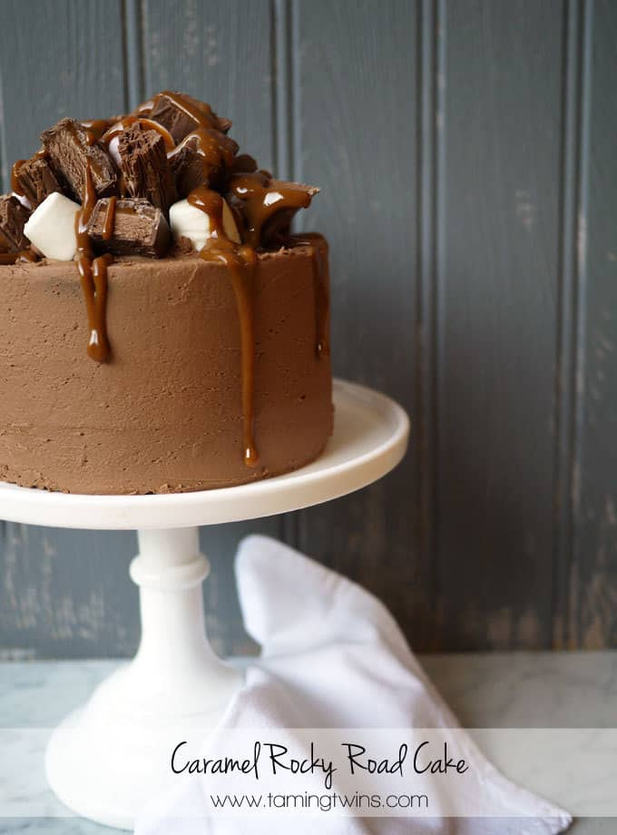 Caramel Rocky Road Layer Cake - The ultimate chocolate cake, stacked with chocolate pieces, marshmallows and delicious caramel.