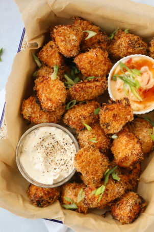 Homemade chicken nuggets coated in breadcrumbs with dipping sauces.
