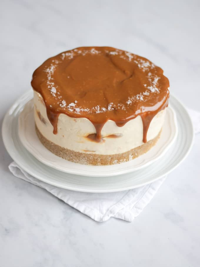 Salted caramel cheesecake, no bake on a white plate and white marble background.