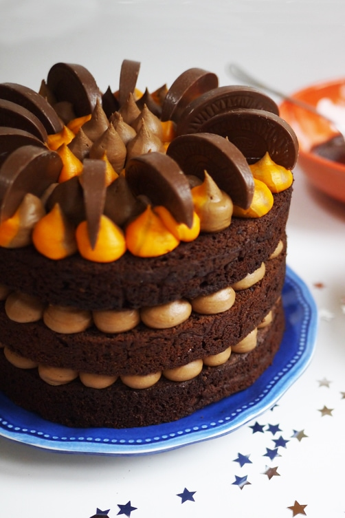 Terry's Chocolate Orange Cake Recipe - Lovely layers of moist chocolate sponge cake, sandwiched with chocolate orange buttercream frosting. It's not Terry's Chocolate Orange Layer Cake Recipe... It's mine! #tamingtwins #chocolatecake #chocolate #chocolateorange #christmas #christmasfood #festivefood #christmascake #holidayfood #holidays #chocolateorangecake