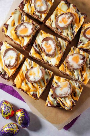 Creme Egg Rocky Road pieces cut up on a board.