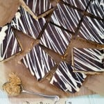 Peanut Butter Crunch Bars - Deliciously, moreish and easy to make tea time treats. Packed with peanut butter and topped with a slab of milk chocolate, these are a must bake! http://www.TamingTwins.com