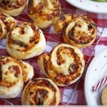 Easy Peasy Pizza Whirls - A great teatime recipe for children and families. These also make a super lunchbox filler or picnic treat. Get the kids cooking, helping to make them too, they're great fun! https://www.tamingtwins.com