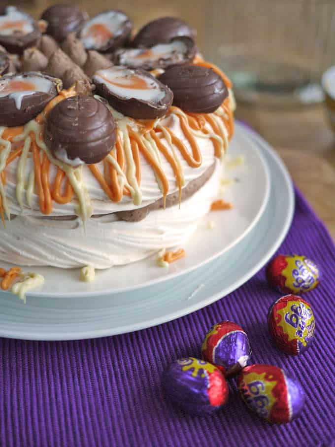 Cadbury's Creme Egg Pavlova Recipe - A delicious, super quick, Easter dessert. You can whip this pudding up in just 5 minutes for real holiday WOW factor! https://www.tamingtwins.com