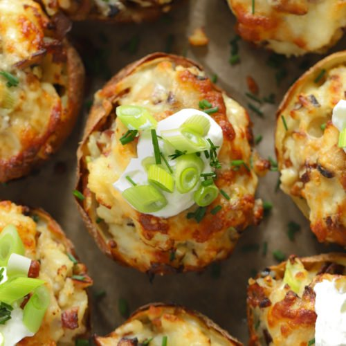 Loaded potato skins topped with sour cream and cheese and bacon