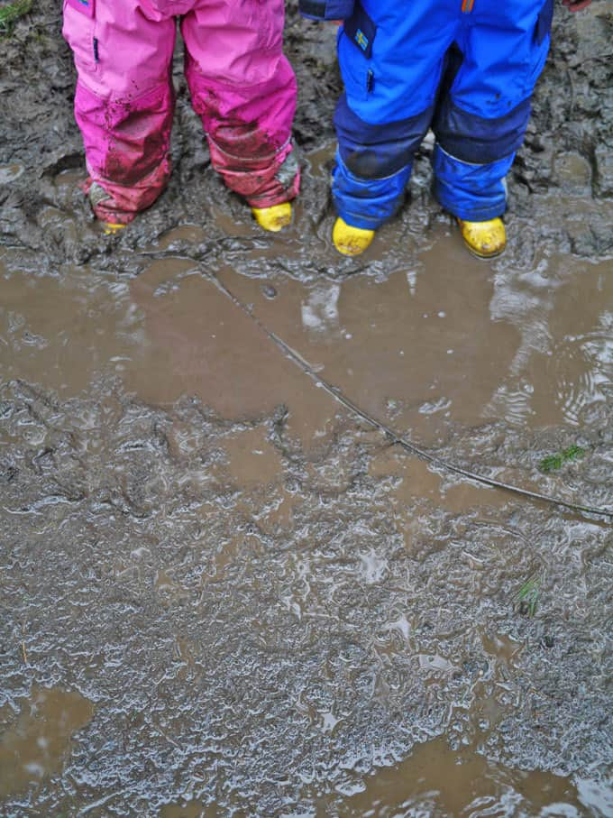 Save this post for those grey rainy days when you just DO NOT know what to do with the kids! Tips and ideas for playing outside even when the weather is terrible | https://www.tamingtwins.com