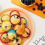 Blueberry muffins made with Optiwell yoghurt drink, for a higher protein cake. Perfect for breakfast or an afternoon tea treat. https://www.tamingtwins.com