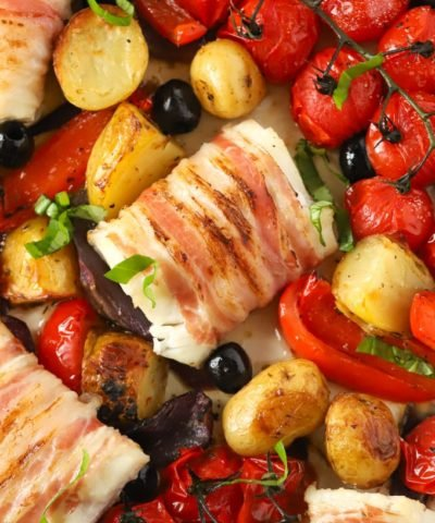 Oven baked cod recipe with tomatoes, peppers, potatoes, olives and pancetta