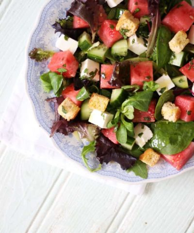 A feta, watermelon and mint salad with baby leaves and rocket. A light and delicious summer salad, with added croutons to make a meal of it. Perfect for an al fresco lunch or dinner. https://www.tamingtwins.com