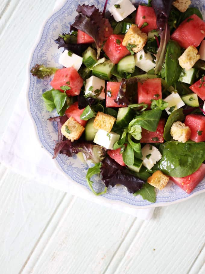 A watermelon feta salad with fresh mint dressing, baby leaves and rocket. A light and delicious summer salad, with added croutons to make a meal of it. Perfect for an al fresco lunch or dinner. https://www.tamingtwins.com