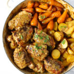 Honey and mustard chicken in a le creuset dish with carrots and potatoes