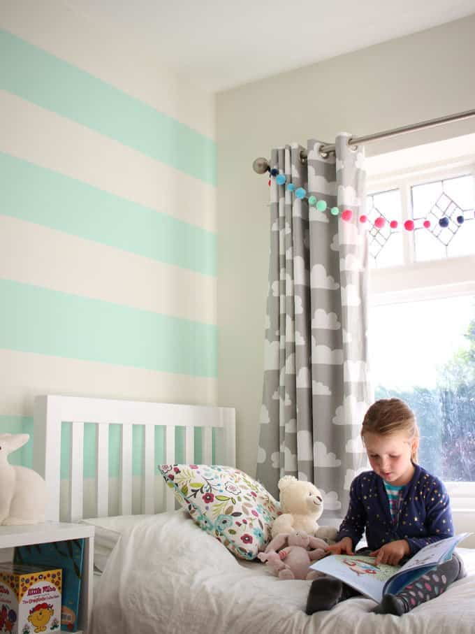 Mint green striped wall love! A little girl's pink and mint green bedroom tour. Inspiration and decoration ideas for a perfect room for a four year old girl.