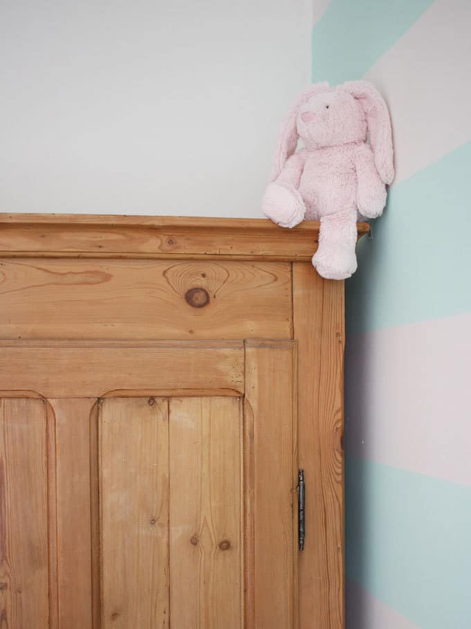 Antique pine wardrobe works perfectly in this room.. A little girl's pink and mint green bedroom tour. Inspiration and decoration ideas for a perfect room for a four year old girl.