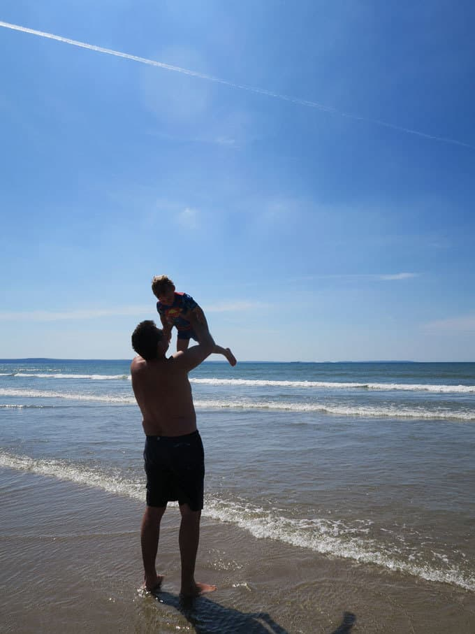Newgale Beach - Discovering Pembrokeshire, Wales - 48 Hours with kids in this stunning part of the UK. Beautiful coastlines, beaches, lighthouse and views, with amazing food and blue skies. What more could you want for a holiday?