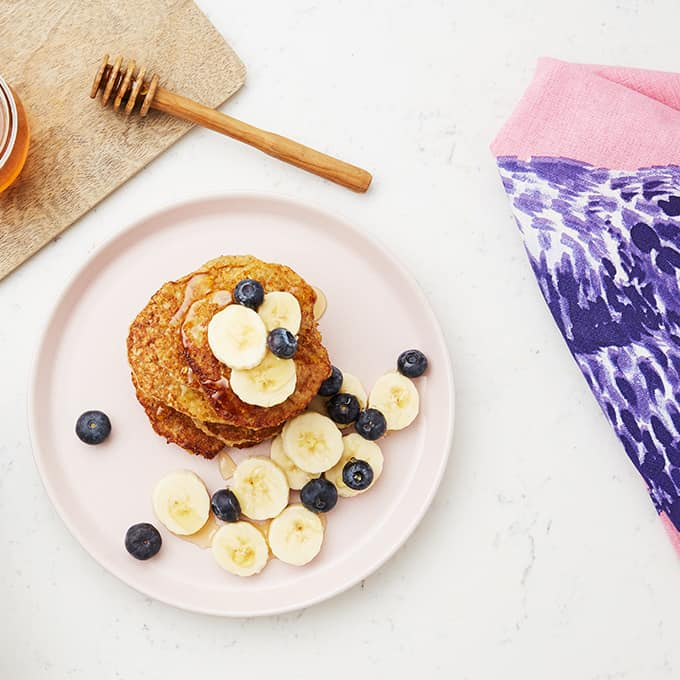 Gluten free blueberry pancakes made deliciously tasty with high protein yogurt drink, Optiwell.