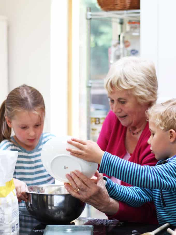 Grandma cooking with granddaughter and grandson