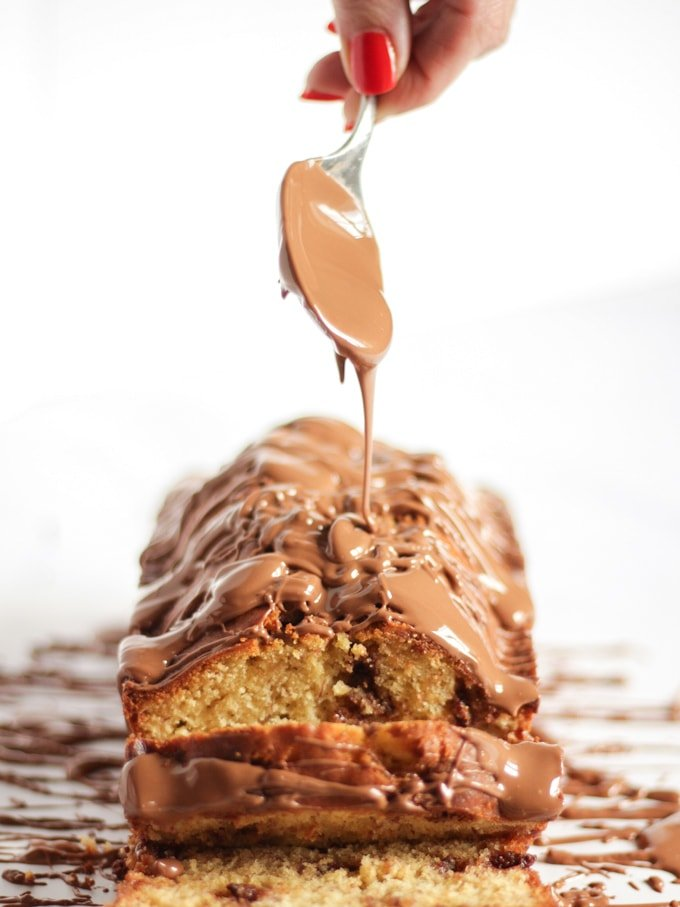 Banana cake with chocolate being poured on