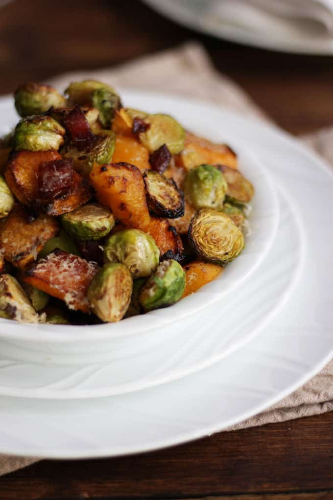 Oven baked Brussels sprouts with bacon, butternut squash and Parmesan cheese. The best ever Brussels sprouts, oven roasted for the perfect Christmas side dish.