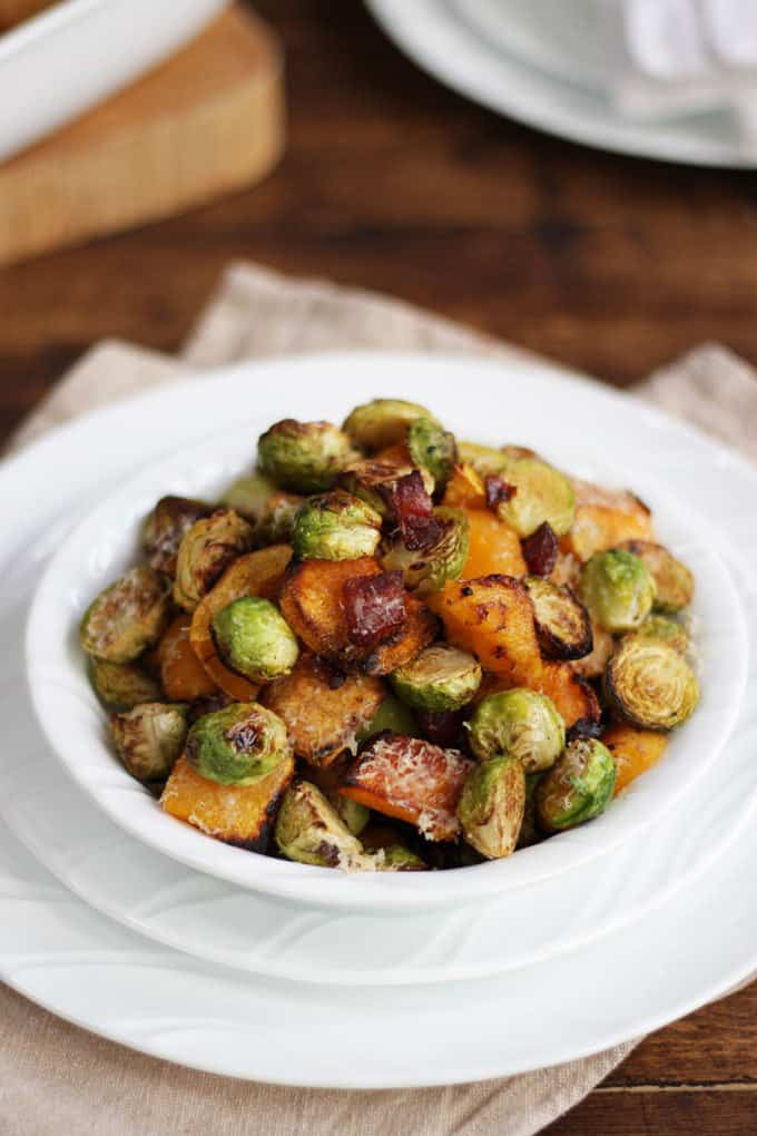 Oven baked Brussels sprouts with butternut squash, bacon and Parmesan cheese. The best ever Brussels sprouts, oven roasted for the perfect Christmas side dish.