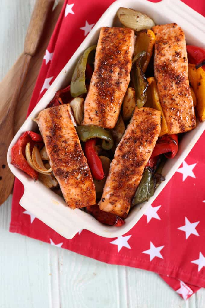 This one tray oven baked Cajun salmon, is an easy, one pan dinner, perfect for a tasty midweek meal. Complete with spiced potato wedges and vegetables.